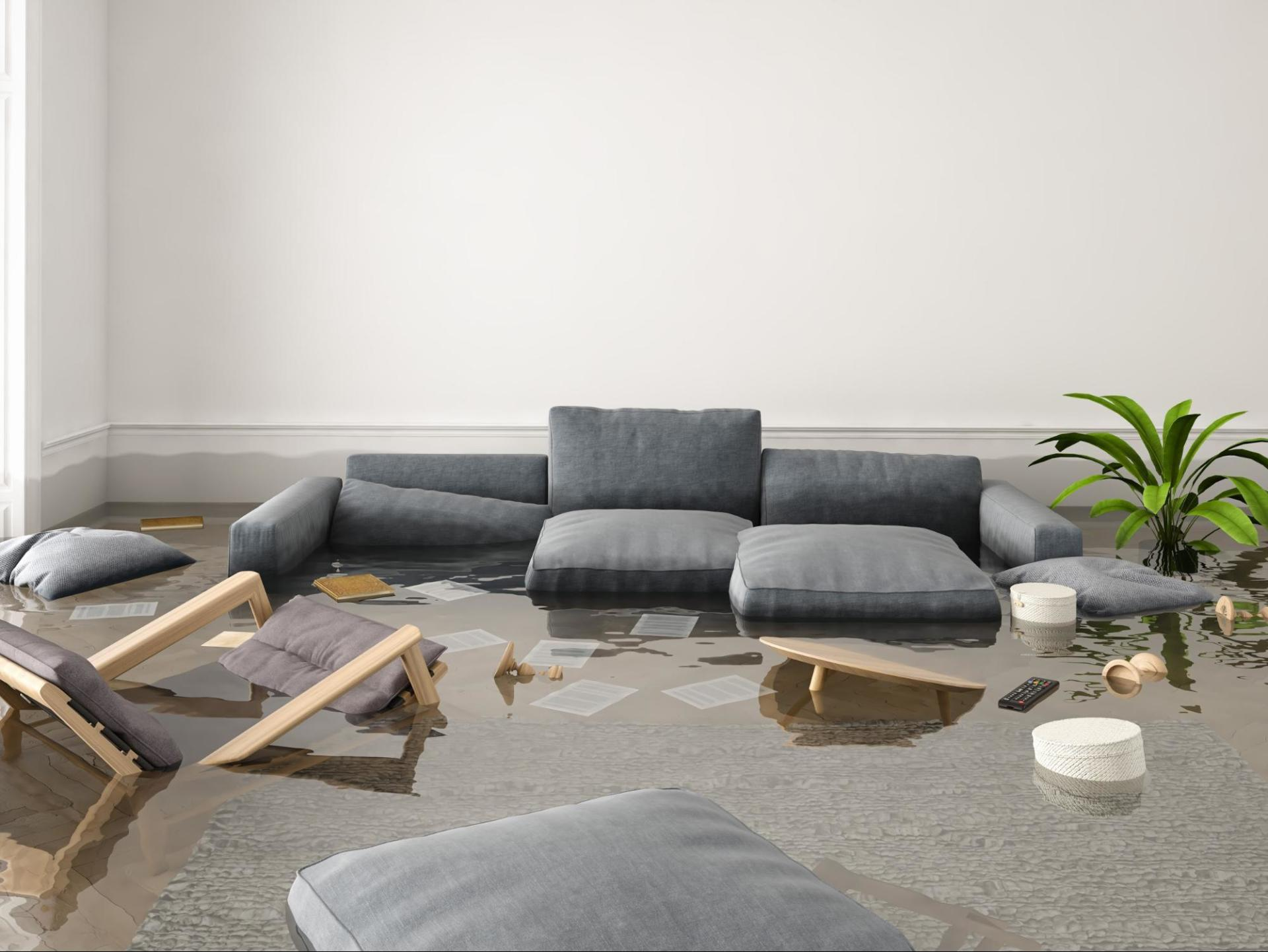 A flooded house filled with furniture and water